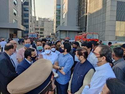 Thackeray visits Serum Institute after fire, loss pegged at Rs 1K cr