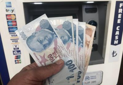 Turkish lira tumbles after sacking of central bank head
